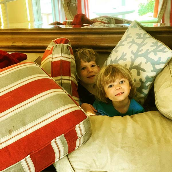 Image of Hoover's children are playing hide and seek at home