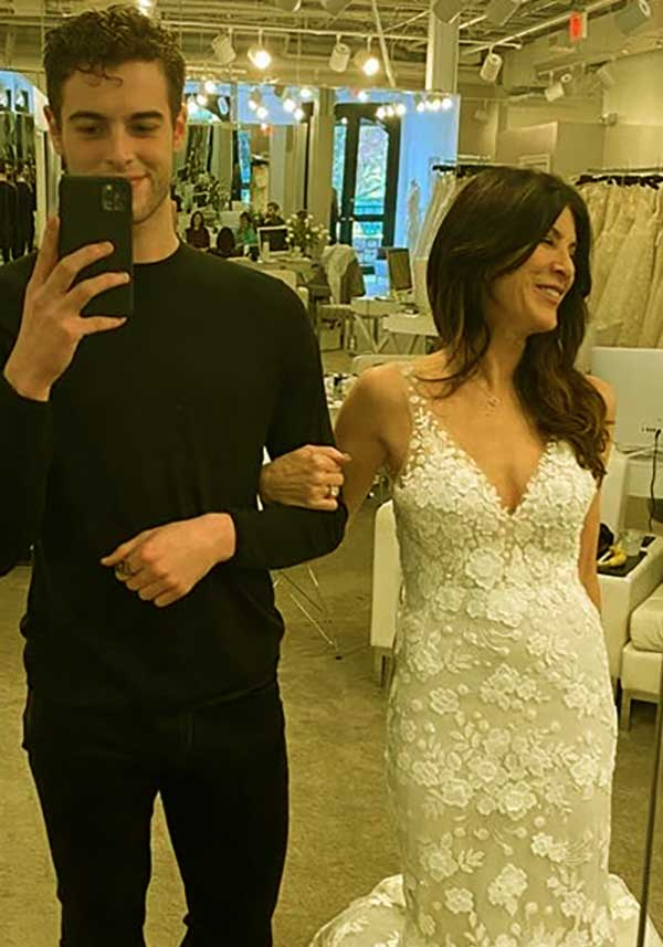 Image of Natalie Allen trying dresses for her wedding with her son